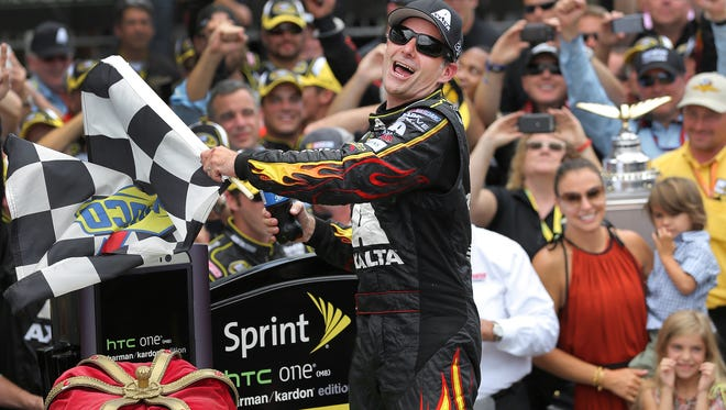 NASCAR driver Jeff Gordon celebrates his fifth Brickyard 400 race win in Victory Circle at the Indianapolis Motor Speedway Sunday, July 27, 2014.