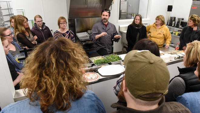 Chef Matt Annand talks about various ingredients to be used during a class on preparing sushi Wednesday, March 21, at Sprout Growers & Makers Marketplace in Little Falls.