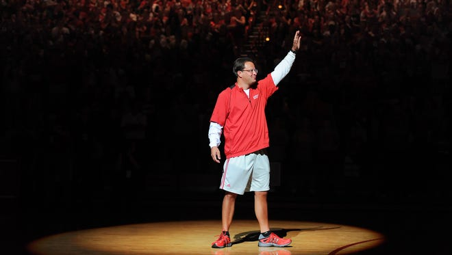 FILE -- IU Men's Basketball Head Coach Tom Crean greets his fans while being introduced during Hoosier Hysteria in Assembly Hall, Oct. 4, 2013.