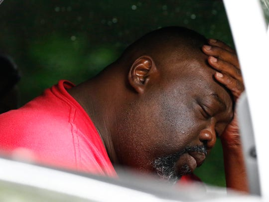 """Vincent Mitchell reflects on his escape and the deaths of family members Sunday, May 28, 2017, outside his Bogue Chitto, Miss., home. A man was arrested Sunday in a house-to-house shooting rampage that left several people dead, including a sheriff's deputy. """"I'm devastated. It don't seem like it's real,"""" Mitchell said."""