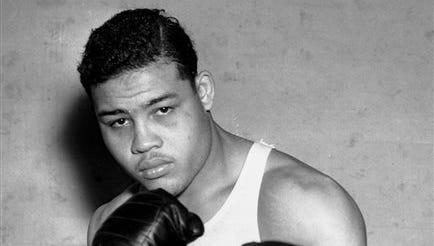 FILE - This Jan. 24, 1937 file photo shows boxer Joe Louis, nicknamed the Brown Bomber, posing in Pompton Lakes, N.J.