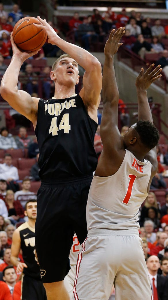 Purdue's Isaac Haas, left, shoots over Ohio State's