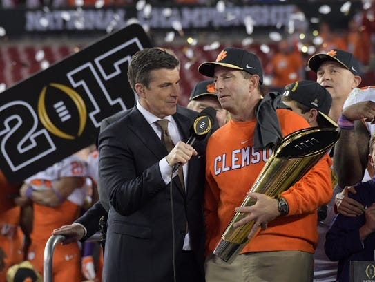 Clemson coach Dabo Swinney is interviewed while after