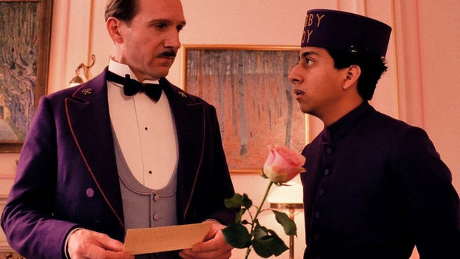"Ralph Fiennes (left) and Tony Revolori star in ""The Grand Budapest Hotel."" See the online version of this story at capecodtimes.com/movies for a link to a Plimoth Plantation feast inspired by the movie."