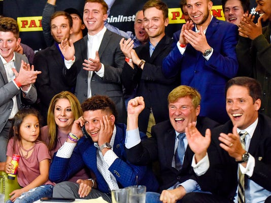 People react as Texas Tech quarterback Patrick Mahomes, at center in bottom row, was selected by the Kansas City Chiefs with the No. 10 pick overall, during an NFL football draft watch party in Tyler, Texas, Thursday, April 27, 2017. (Chelsea Purgahn/Tyler Morning Telegraph via AP)