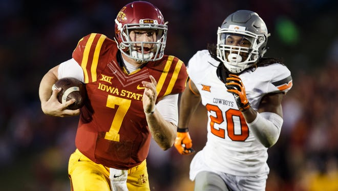 Iowa State's Joal Lanning runs for a touchdown to make it 30-21 as Oklahoma State's Jordan Burton during their game at Jack Trice Stadium on Saturday, November 14, 2015 in Ames, Iowa.