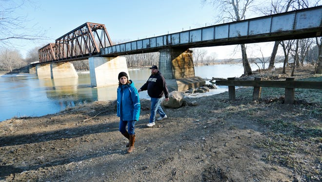 Dawn Barngrover and Chris Galbreth check the area around Davis Ferry while conducting the Point in Time homeless survey Thursday, January 28, 2016, in Lafayette. Local homeless service agencies take part in the Point in Time survey, which is taken each January to assess the number of homeless in the area. The survey is required for Federal Funding. Barngrover is director of enrichment services for Wabash Center. Galbreth is a case manager for Wabash Center.