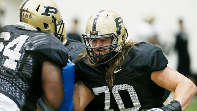 Offensive guard Jordan Roos, right, and lineman Johnny Daniels during spring football practice Thursday, March 31, 2016, inside the Mollenkopf Athletic Center at Purdue University.