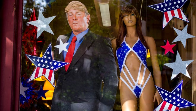 A Trump cutout stands next to a mannequin at Adultmart in Cleveland on Monday, the first day of the Republican National Convention.