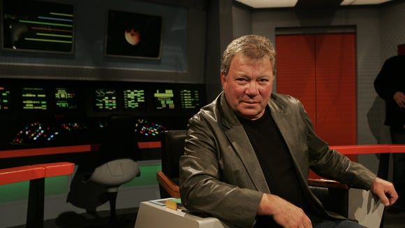 "William ""Captain James Kirk"" Shatner sits in the original captain's chair from Star Trek the Original Series"
