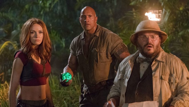 Karen Gillan, from left, Dwayne Johnson and Jack Black find dangers in a video-game world in 'Jumanji: Welcome to the Jungle.'