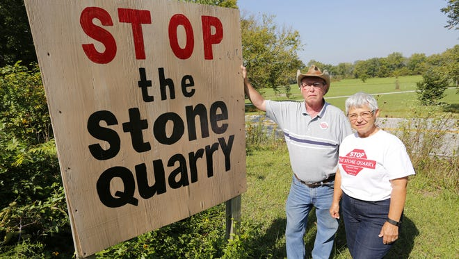 Bill and Kay Miller, opponents of a proposed stone quarry, in their front near Americus.