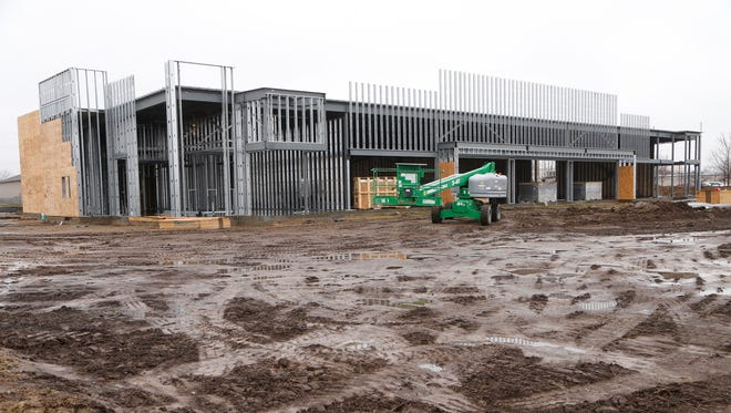 New strip mall under construction Tuesday, March 27, 2018, on Veterans Memorial Parkway. Leases for the new mall being constructed by TMG Construction Management include Arby's, Sprint and Pizza Hut. Addition space remain to be filled. Construction should be completed by May or June, weather permitting.