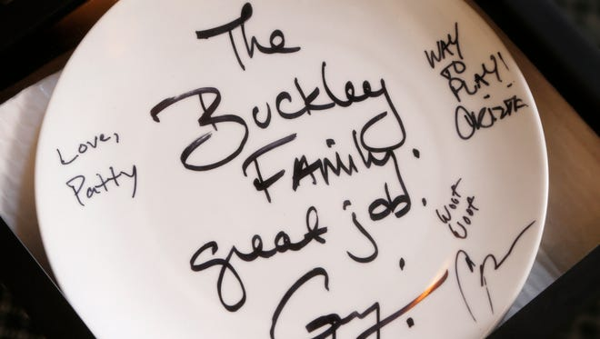 A commemorative plate given to the Buckley Family by Guy Fieri and the crew of Guy's Grocery Games displayed Tuesday, July 17, 2018, at Bistro 501, 501 Main Street in downtown Lafayette. Bistro 501 is featured in an upcoming episode of Guy's Grocery Games on Food Network.
