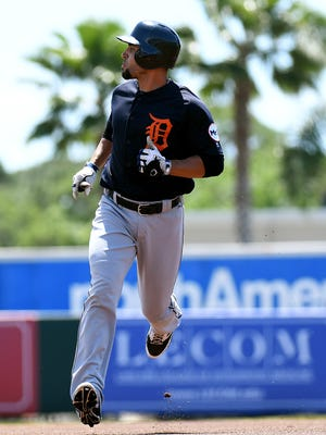 Mar 30, 2017; Sarasota, FL, USA; Tigers infielder Omar Infante watches his solo home run in the first inning of the spring training game against the Baltimore Orioles at Ed Smith Stadium.
