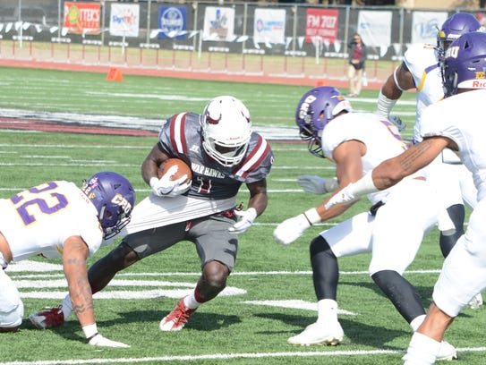 McMurry receiver Eriel Dorsey is brought down by a