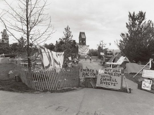 "Students and faculty built a ""shanty town"" made of cardboard and wood outside Day Hall in 1985. They also held sit-ins and demonstrations, demanding that university trustees divest Cornell's investments in companies doing business in South Africa."