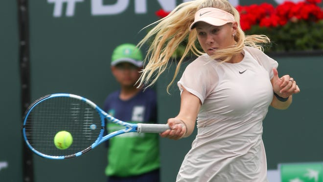 Amanda Anisimova of the United States hits a forehand against Paulina Parmentier of France at the BNP Paribas Open, March 7, 2018.