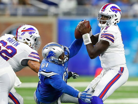 Lions defensive end Kerry Hyder knocks the ball free from Bills rookie quarterback Cardale Jones during the fourth quarter of the preseason game at Ford Field on September 1, 2016 in Detroit, Michigan.