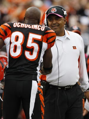 Bengals head coach Marvin Lewis shakes hands with Chad Ochocinco against the Chicago Bears in October of 2009.