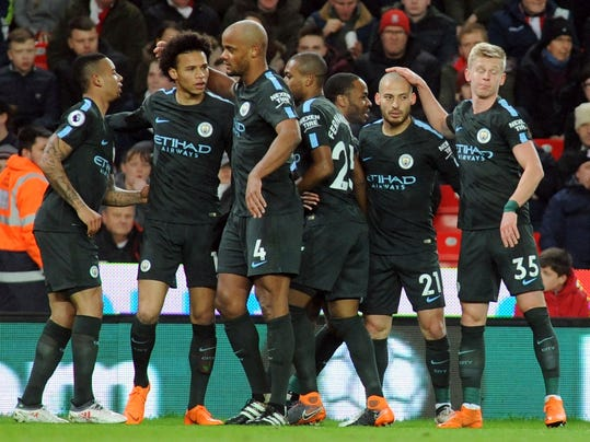 Manchester City's David Silva, second right, celebrates with teammates after scoring his side's first goal during the English Premier League soccer match between Stoke City and Manchester City at the Bet 365 Stadium in Stoke on Trent, England, Monday, March 12, 2018. (AP Photo/Rui Vieira)