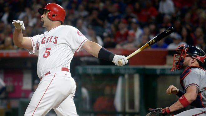 Albert Pujols hits a three-run home run  against the Atlanta Braves at Angel Stadium of Anaheim. The home run was the 599th of Pujols career.