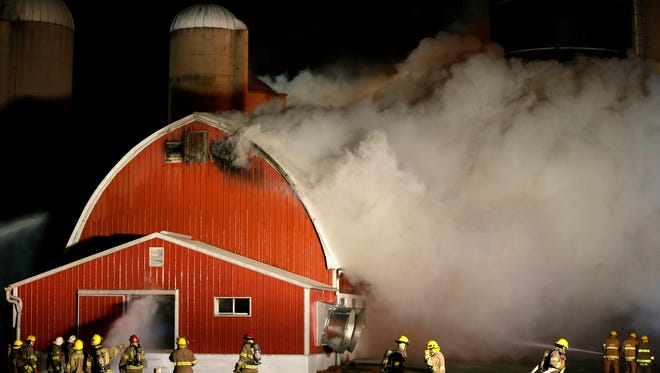Multiple fire departments on the scene of a barn fire on McCabe Rd. near the intersection of Hanson Rd. on November 16, 2014, in the Town of Oneida.