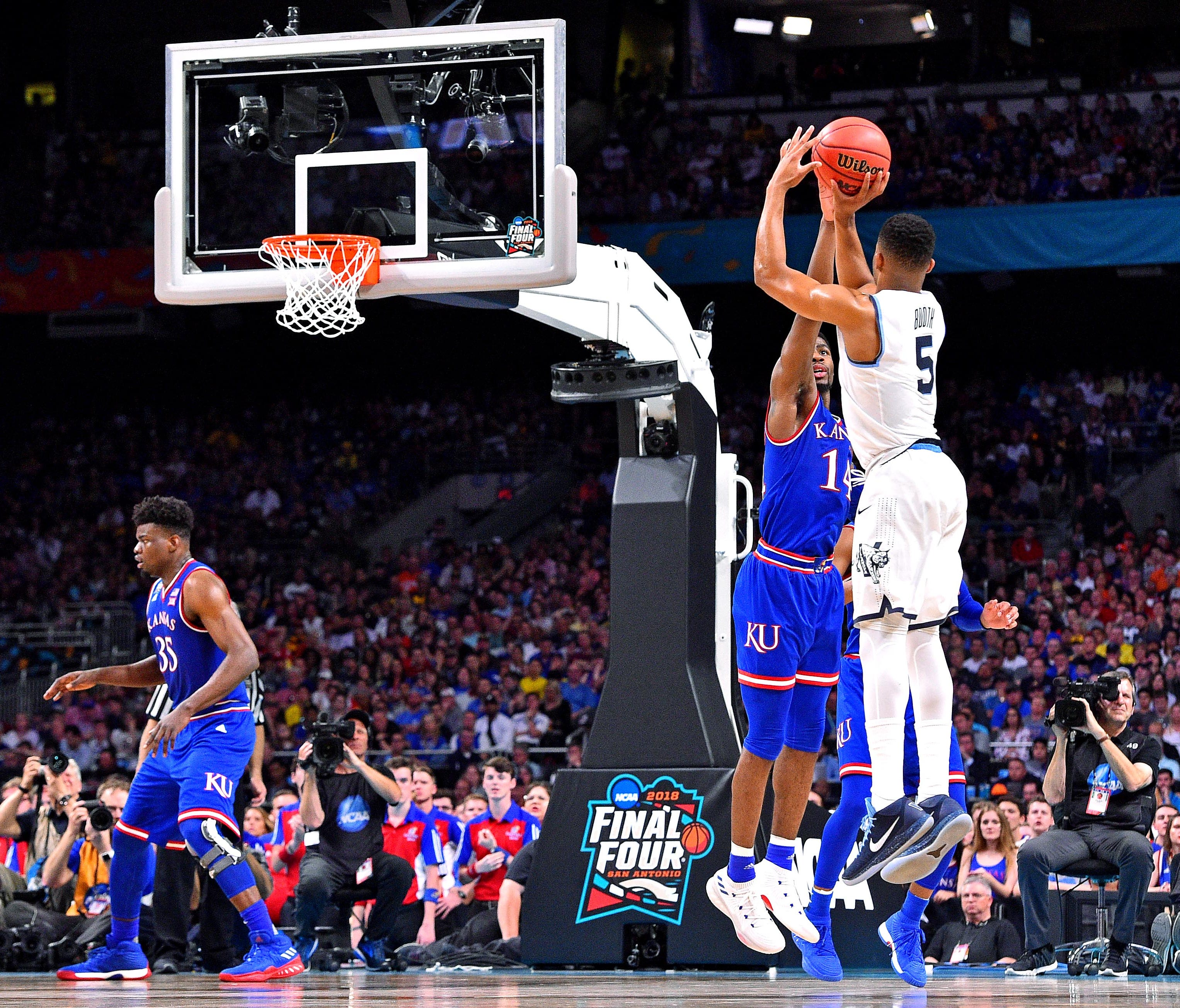 Villanova guard Phil Booth shoots the ball against Kansas during  semifinals of the 2018  tournament at the Final Four at Alamodome.