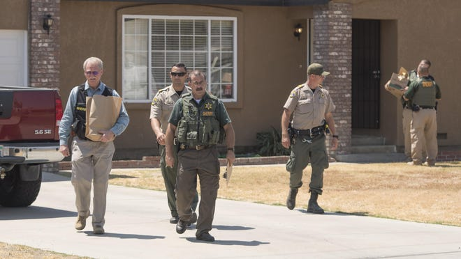 Tulare County deputies remove items from a house on West Hurley Avenue in Visalia on Thursday, August 11, 2016. They were working on Operation Baby Face that began in May and lead to multiple arrests for human trafficking of more than 50 victims ranging in ages from 14 to 37.