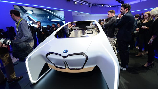 Crowds gather to see a BMW concept vehicle at the BMW Group news conference Wednesday at CES in Las Vegas.