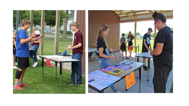 (Left) Josh Sellnerchecked out the Horse Evaluation Career Development booth operated by Adam Johnson, Chapter Treasurer; (Right) Miah Brown, Chapter Officer at Large, talks to Antonio Ruiz (right) about the Vet Science CDE opportunity at Junior High FFA Discovery Camp.