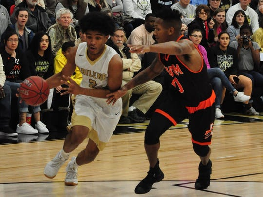 Abilene High's David Russell drives around Haltom City Haltom's Imiee Cooksey during the Eagles' 62-59 win Friday, Jan. 13, 2018, at Eagle Gym.