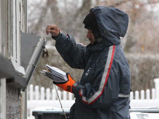 Jose Colon delivers mail on Spring Street in Ossining