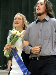 Victoria Purcell of Altoona is escorted by Polk County