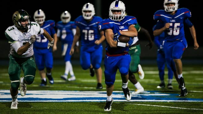 October 5, 2017 - Harding Academy running back Hunter Morgan (12) gains yardage against First Assembly Christian School during the second quarter at Harding on Thursday.