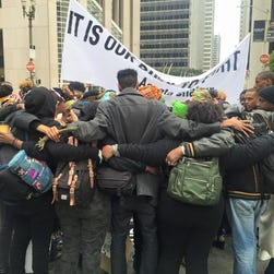 A group of protesters rallying behind the 'Black Lives Matter' slogan blocked parts of downtown San Francisco early Thursday, May 21, 2015.