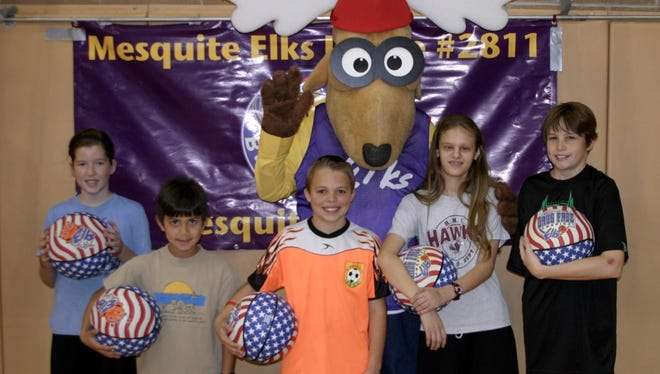 From left to right with Elroy the Elk are – Evia Toone, McKay Mulitalo, Drake Wakefield, Amanda Leavitt, and Matt Boyd