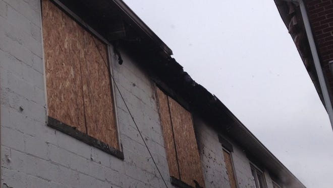 Windows on the second floor of a building are boarded up after a fire in Gettysburg.