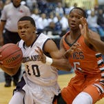Ridgeland's Jonah Simpson (10) get by West Harrison's Zaylan Lee on Thursday in the MHSAA state basketball tournament at the Lee E. Williams Athletics & Assembly Center on the Jackson State University campus.