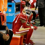 San Francisco 49ers cornerback Kenneth Acker (20) sits on the sideline during the second half of an NFL football game against the Cincinnati Bengals in Santa Clara, Calif., Sunday, Dec. 20, 2015.