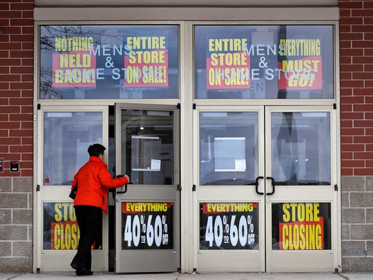 A customer enters a Bon Ton store, which is scheduled