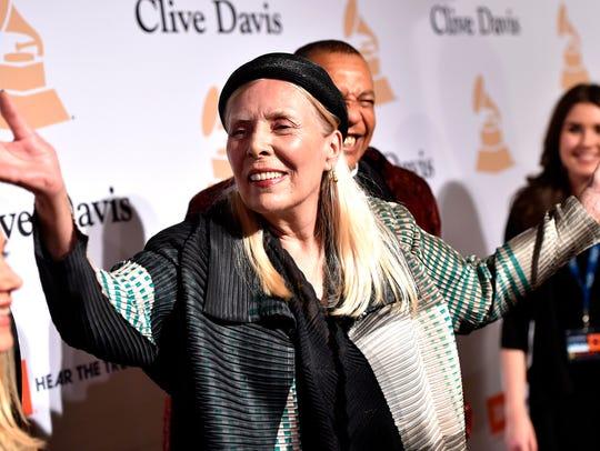 Joni Mitchell arrives at the 2015 Clive Davis Pre-Grammy