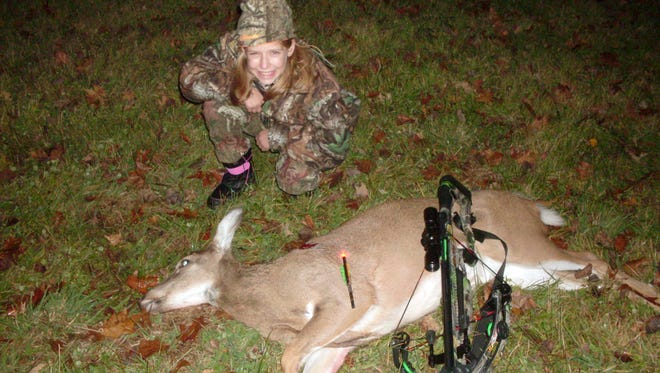 Elizabeth Kunz of Mishicot shows the doe she shot with her crossbow in Waupaca County. She was hunting with her dad, Fran Kunz, under the mentored hunt program when she got her chance to harvest her first deer.