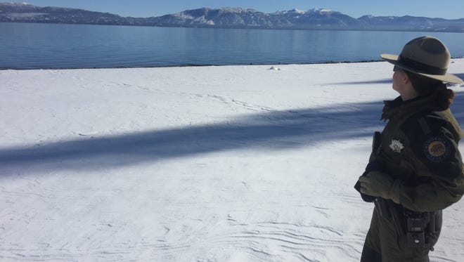 California State Parks Ranger Jennifer McCallan takes a snowshoe hike on the beach at Sugar Pine Point State Park. Even though it was a beautiful day there were no other visitors on the beach.
