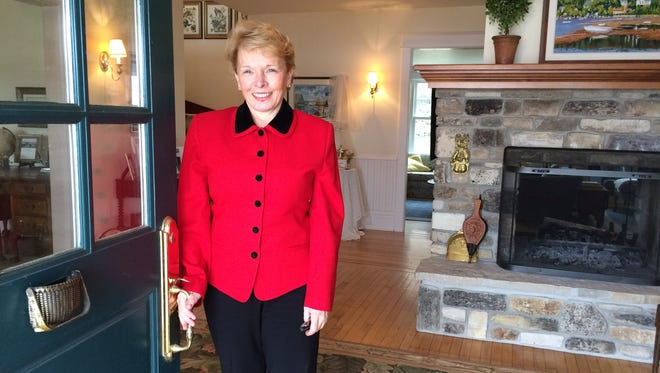 Diane Tallion opens the doors to the Hillside Inn in Ephraim to guests for the first time in years last weekend.