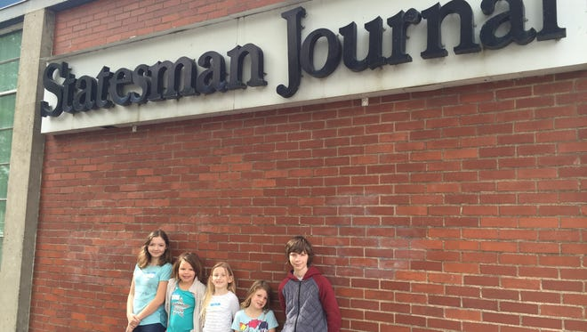 Dakota, left to right, Felicity, Bente, Kendra and Noah participate in Take Our Daughters and Sons to Work Day at the Statesman Journal on Thursday, April 28.
