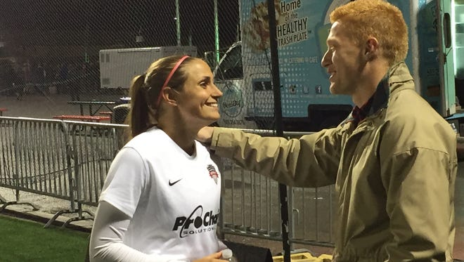 Rhinos goalkeeper Adam Grinwis, right, greets his girlfriend, Shelina Zadorsky, after her Washington Spirit team beat the Western New York Flash, 3-0.