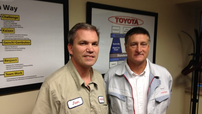 Jason Bates (left), Toyota Bodine administration manager, in a 2013 file photo with Al Hossack, the former general manager and plant manager at Bodine TN in Jackson.