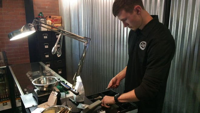 Budtender Colby Freeman, 24, handles the sale of medical marijuana products at 530 Collective Thursday afternoon in Shasta Lake. Its director, Jamie Kerr, says she's fielded a few questions about recreational use and grows in homes. But she expects to start getting more questions as growing season nears.