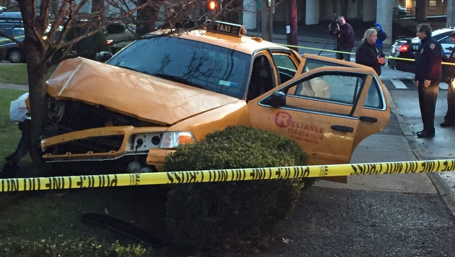 Police investigate after a cab from Reliable Taxi jumped the sidewalk and crashed into a tree outside The Highlands complex at Highland Road and Purchase Street in Rye, Friday, Jan. 13, 2017.